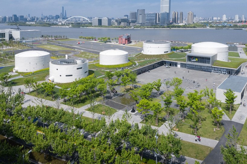 OPEN architecture offers a closer view of tank shanghai, conceived as both an art museum and an open park, revitalizing a derelict site along the banks of shanghai's huangpu river